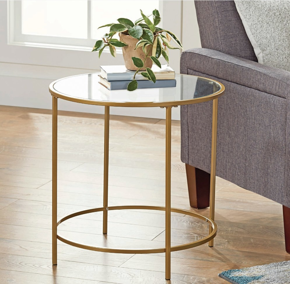 Round end table, glass top, gold metal detailing and legs