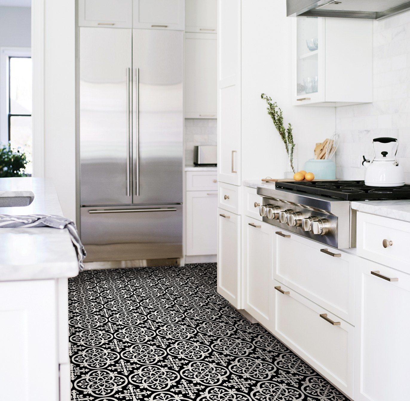 Black and white gothic-style floor tiles in a kitchen