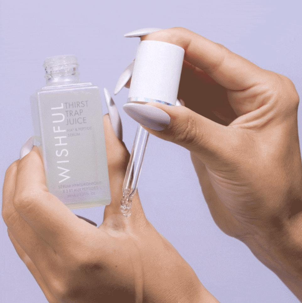A model applying the liquid serum to their hand
