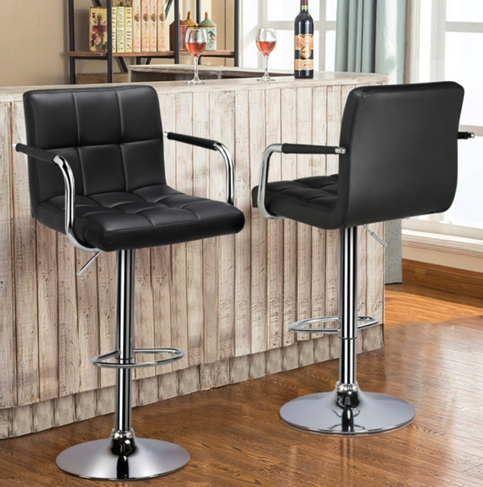 Faux leather black cushioned barstools with silver bottom