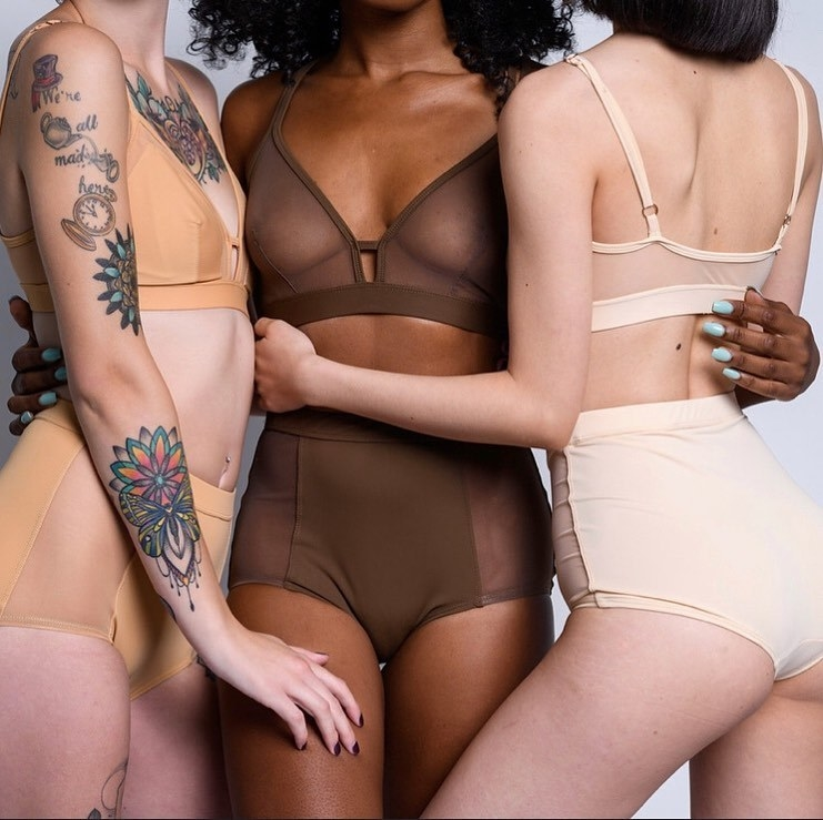 three models wearing matching bralettes and underwear