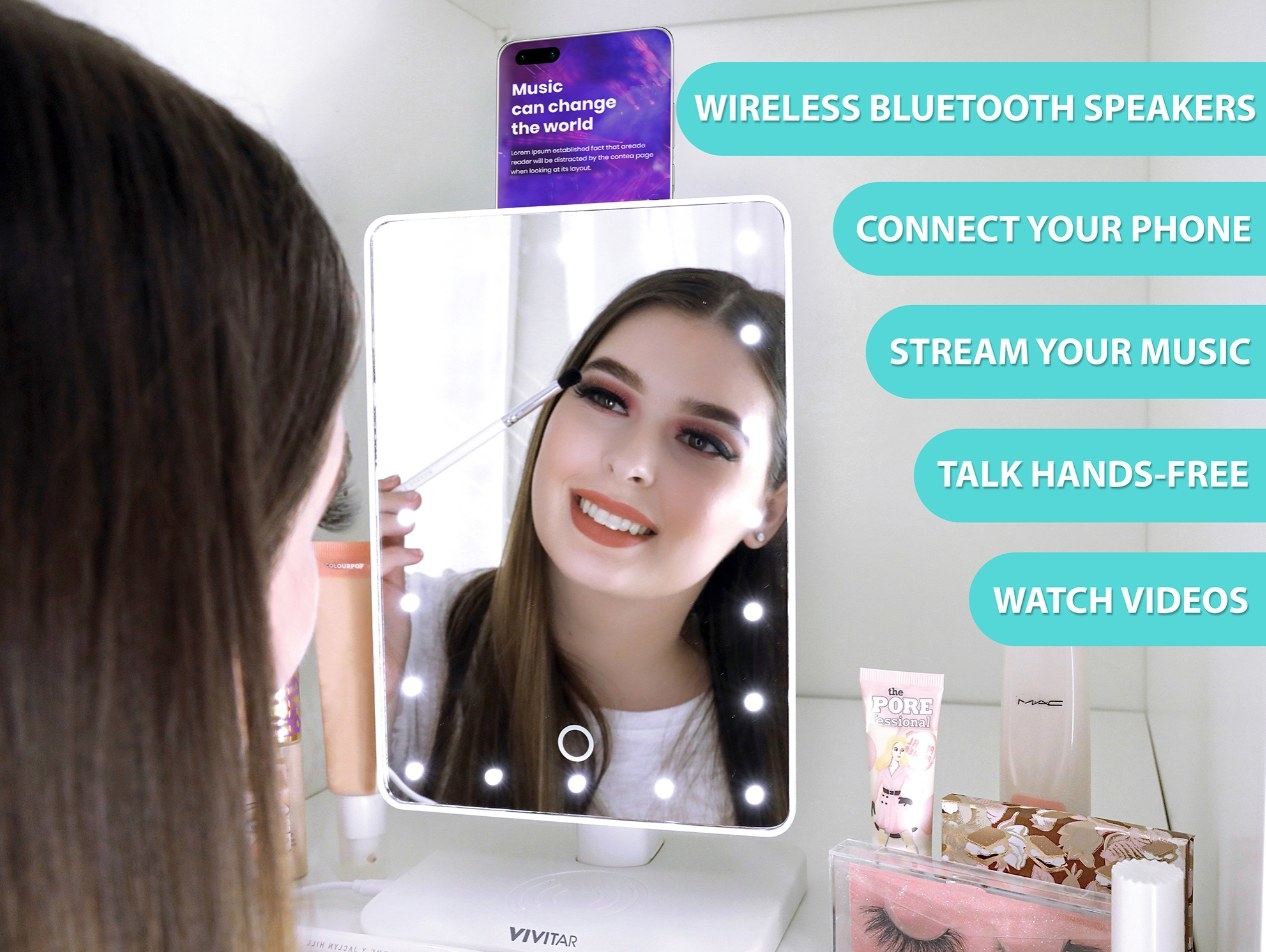Person is applying makeup while looking in a mirror