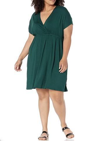 a model in a jewel toned green dress
