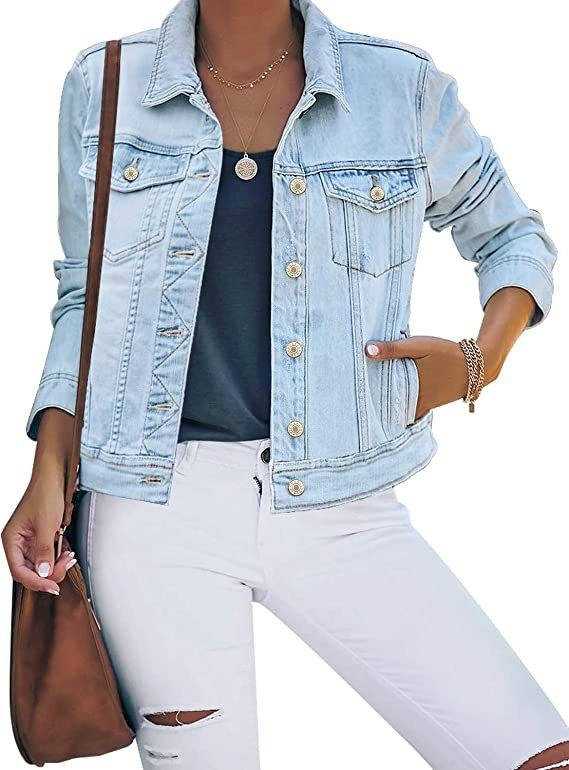 Model wearing the jacket, which hits at the top of the hip