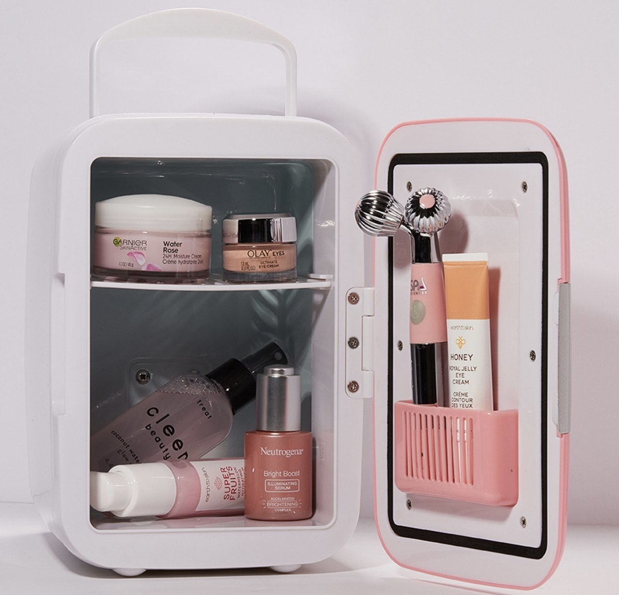 A pink mini fridge with skin care products inside