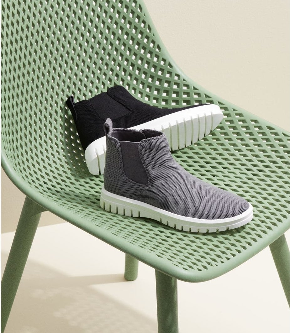 the bootie with white chunky sole and knit panel on either side in grey and black