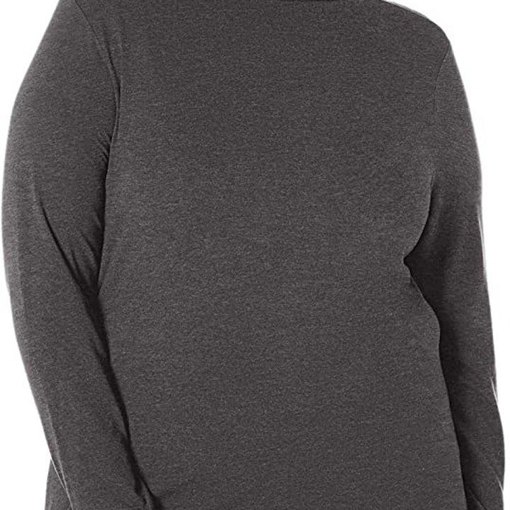 a model wearing a gray turtleneck