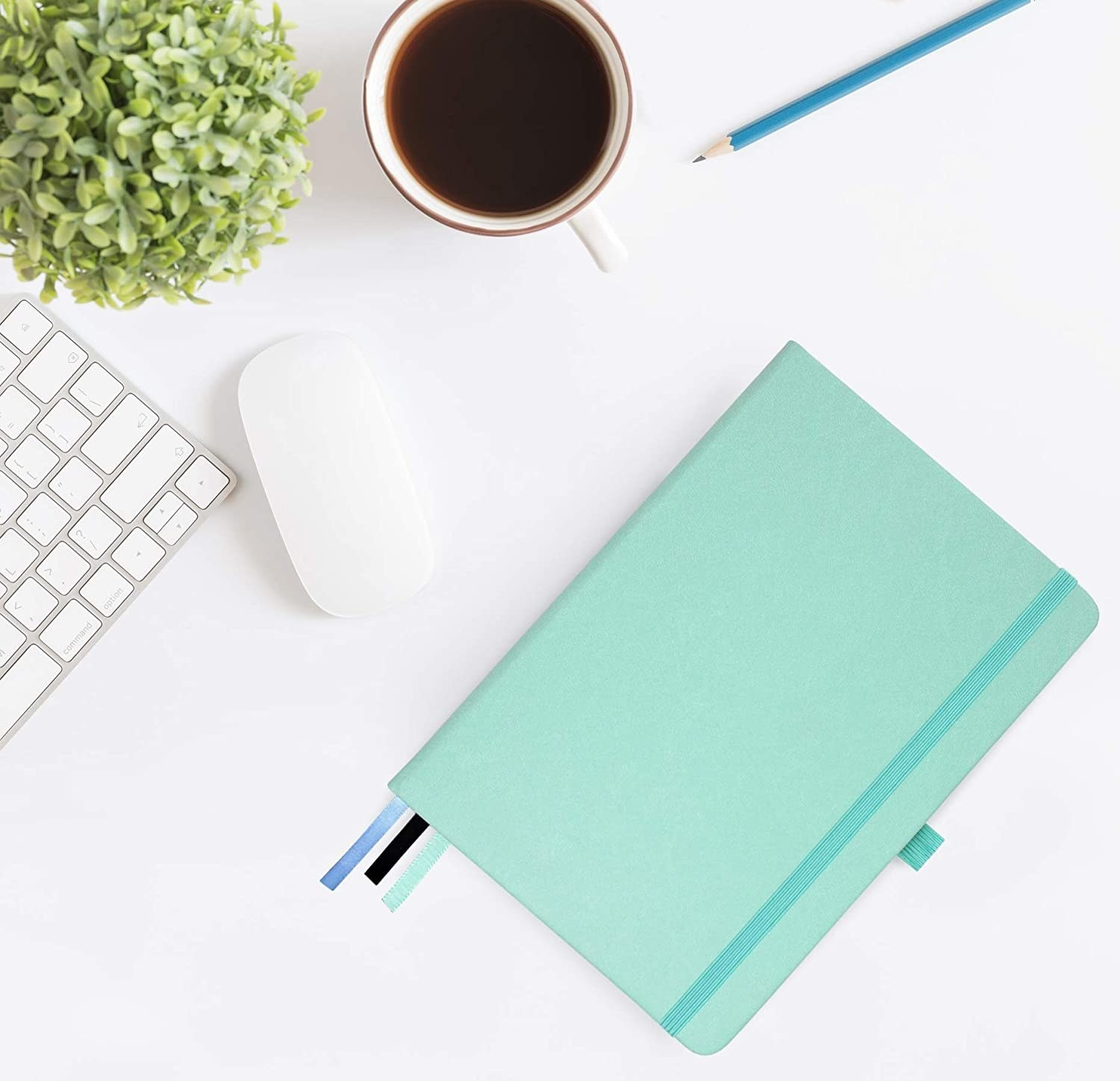 A notebook next to a mouse and keyboard