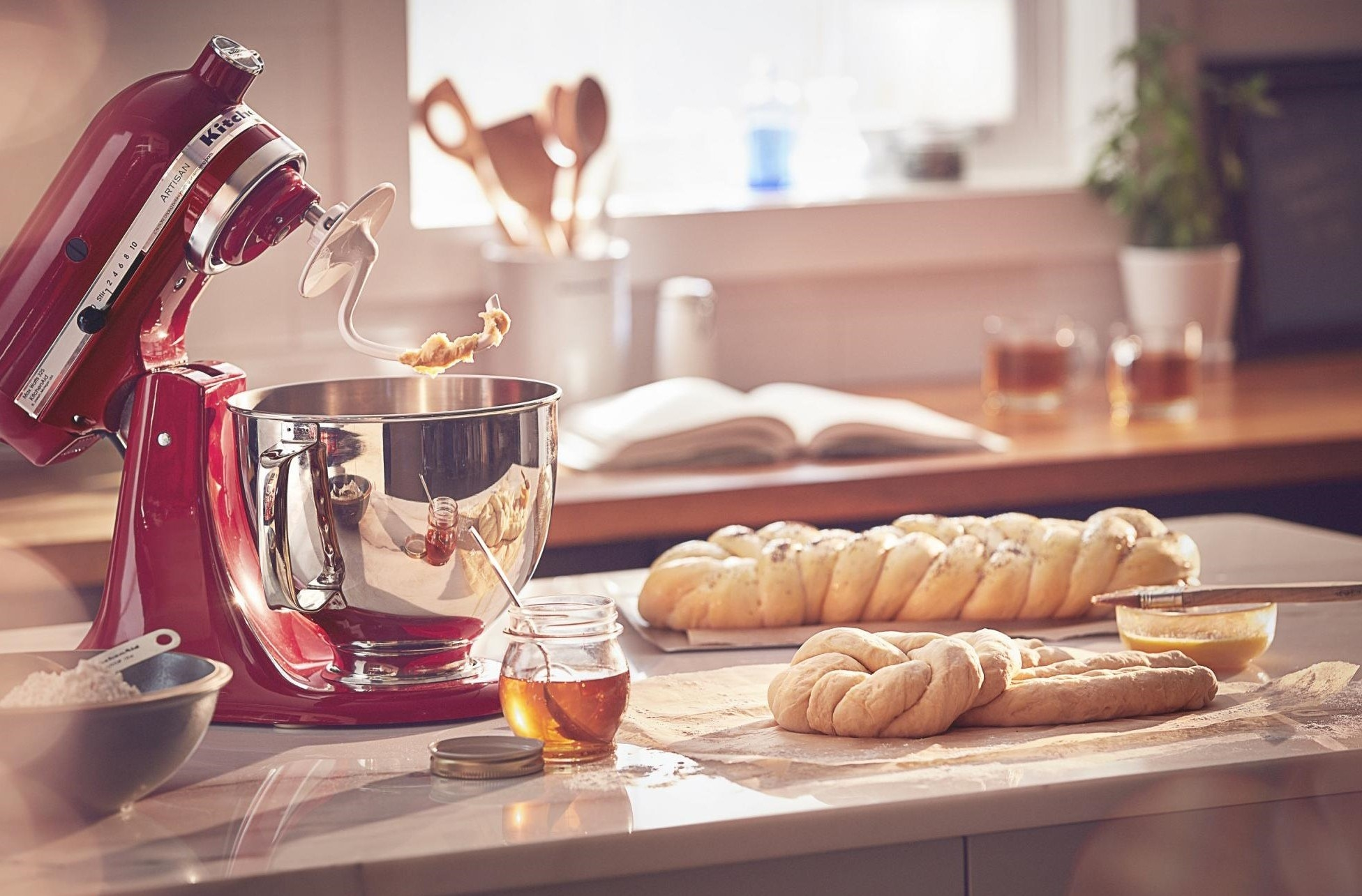 The mixer, shown in a kitchen scene with plaited bread dough
