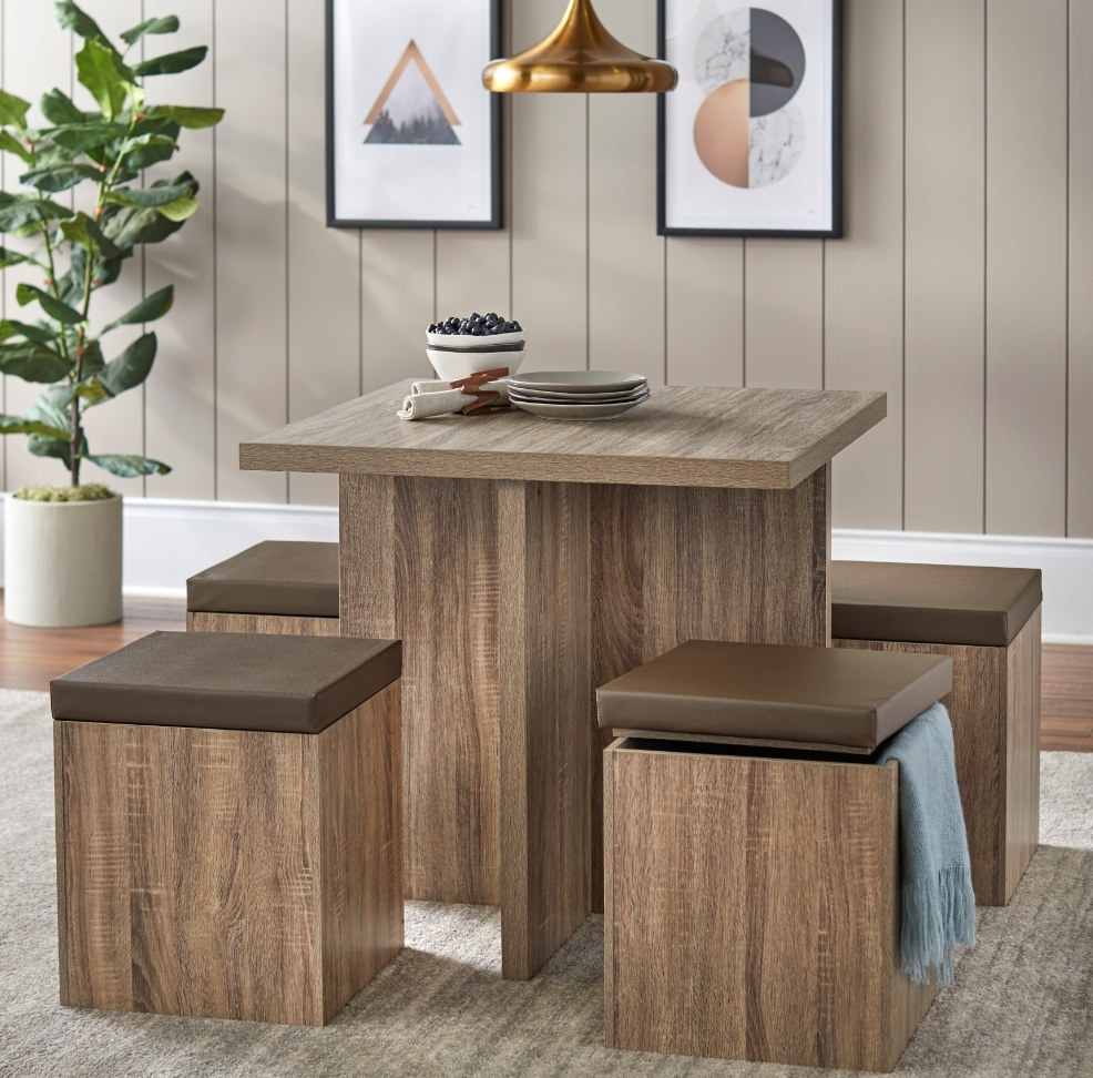 Brown wooden square table with four square ottoman benches
