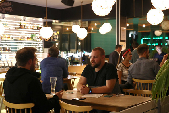 People enjoying socializing inside a restaurant without having to social distance or wear masks