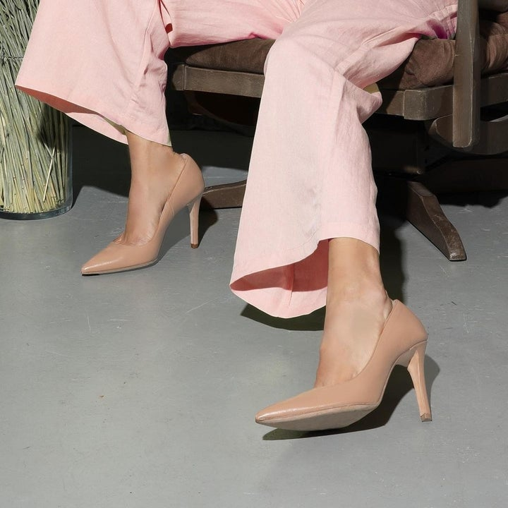 model wearing the high heel in a light tan color