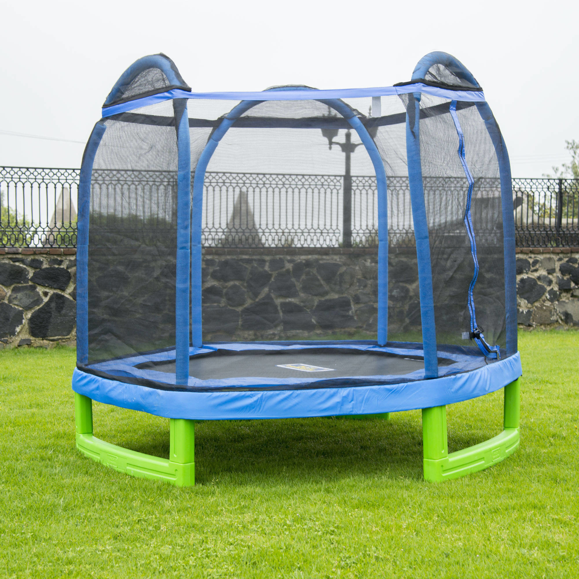 The blue trampoline on a lawn