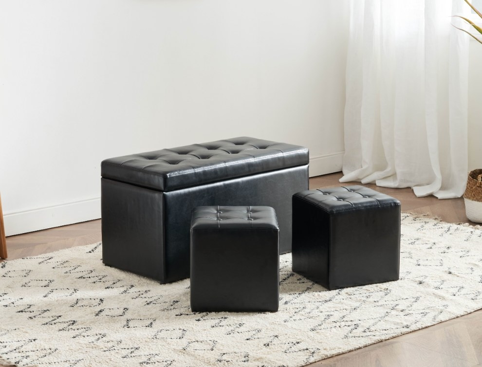 Black faux leather storage bench with two square ottoman foot rests