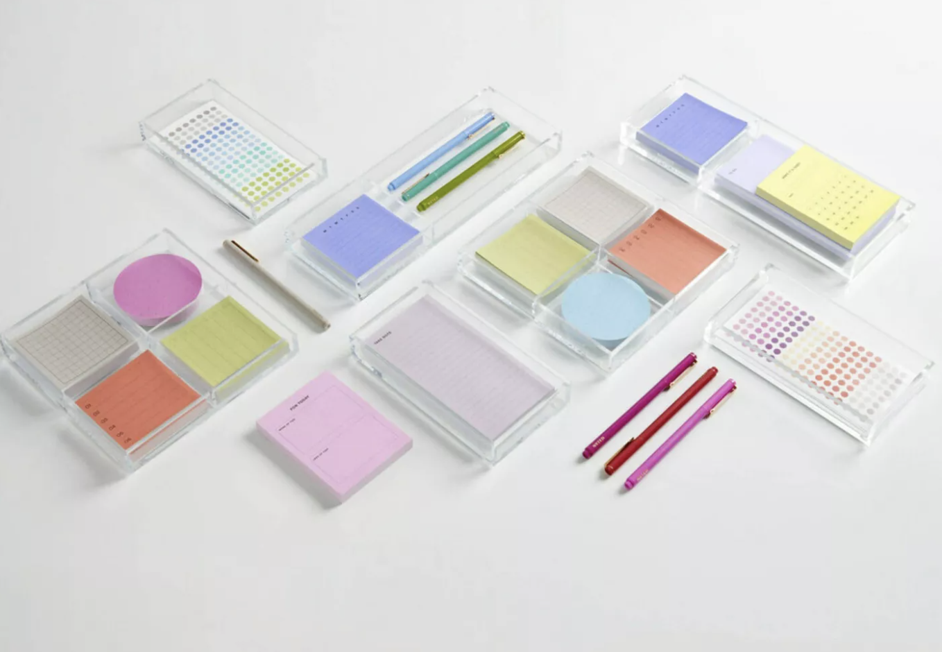 A variety of acrylic Post-it trays and organizers