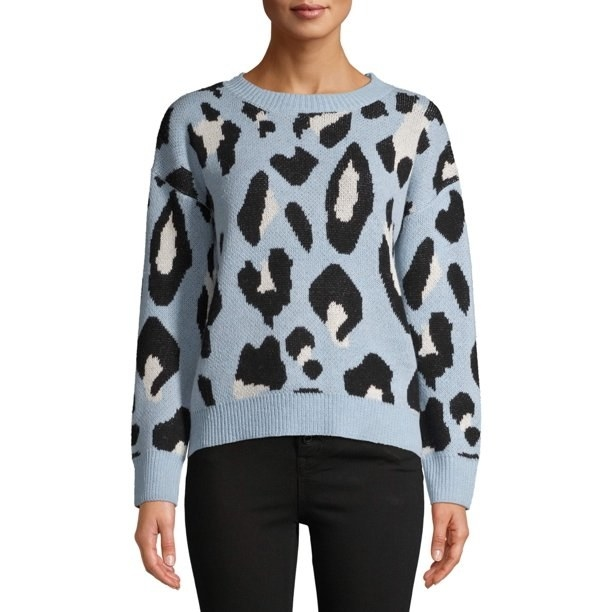 A model wearing the blue leopard sweater
