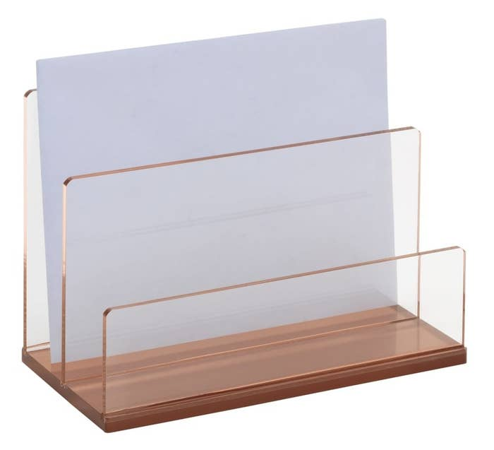 The rose gold organizer which has two acrylic dividers
