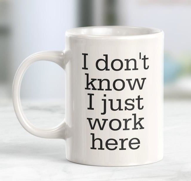 "The white mug which says ""I don't know I just work here"""