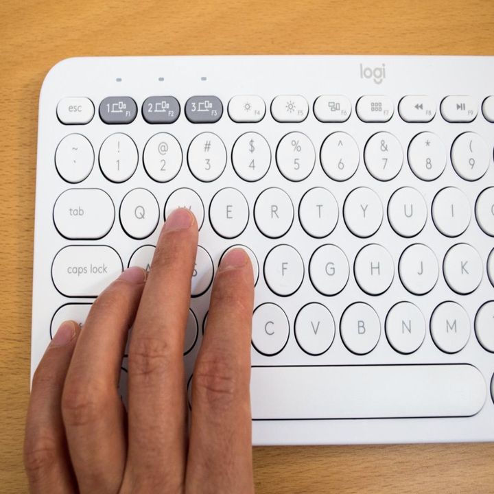 reviewer pressing keys on the white keyboard