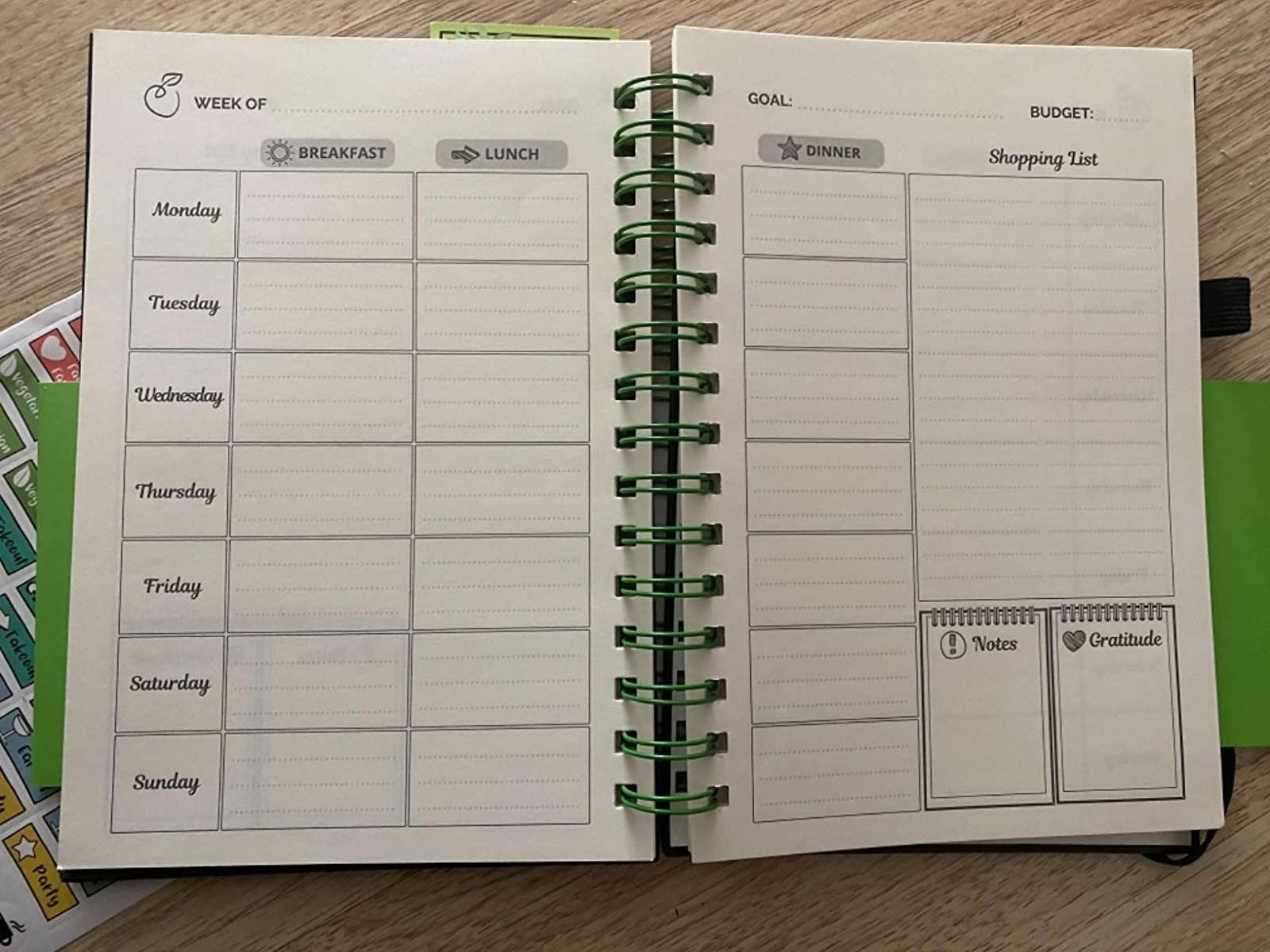 reviewer image of the life and apples meal planner notebook laid open