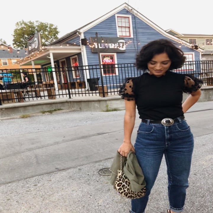 reviewer wearing the mesh puff-sleeve top in black