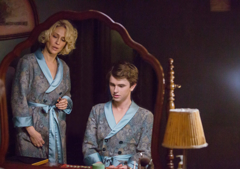 Freddie Highmore and Vera Farmiga wearing matching robes in Bates Motel