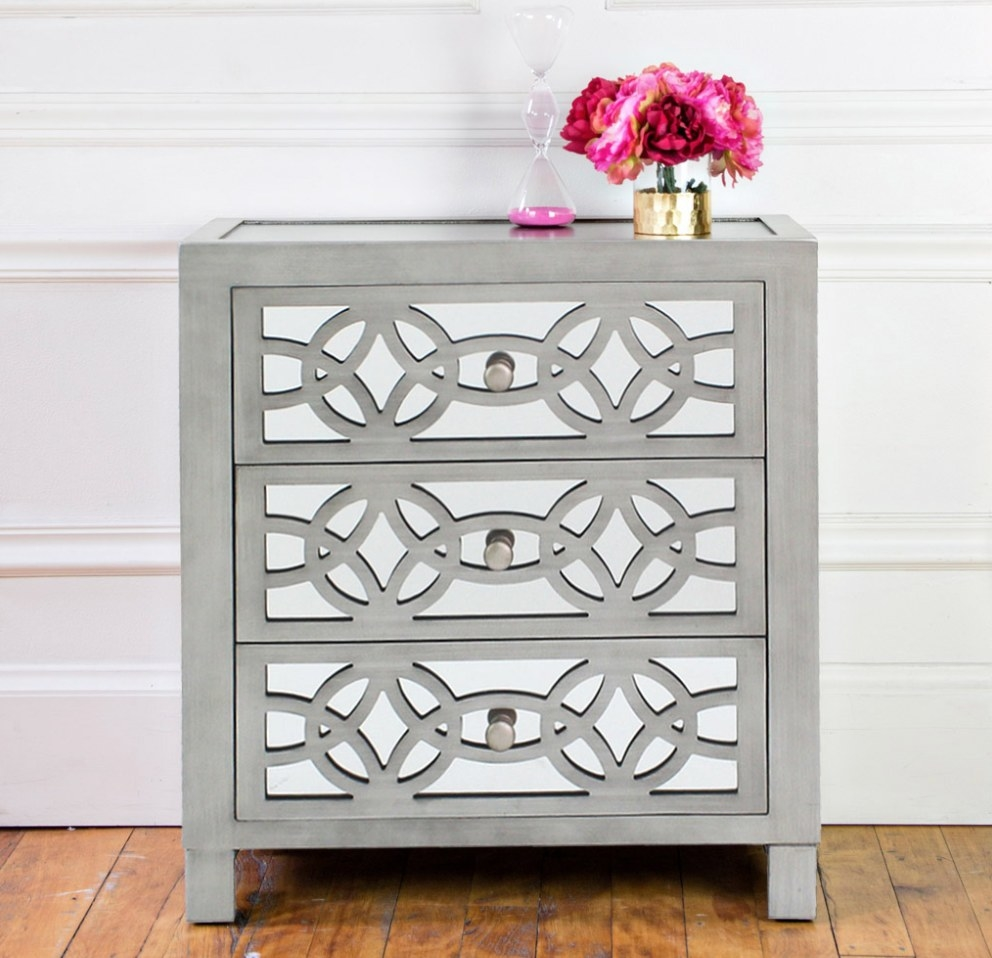 Gray three drawer dresser with mirror detailing