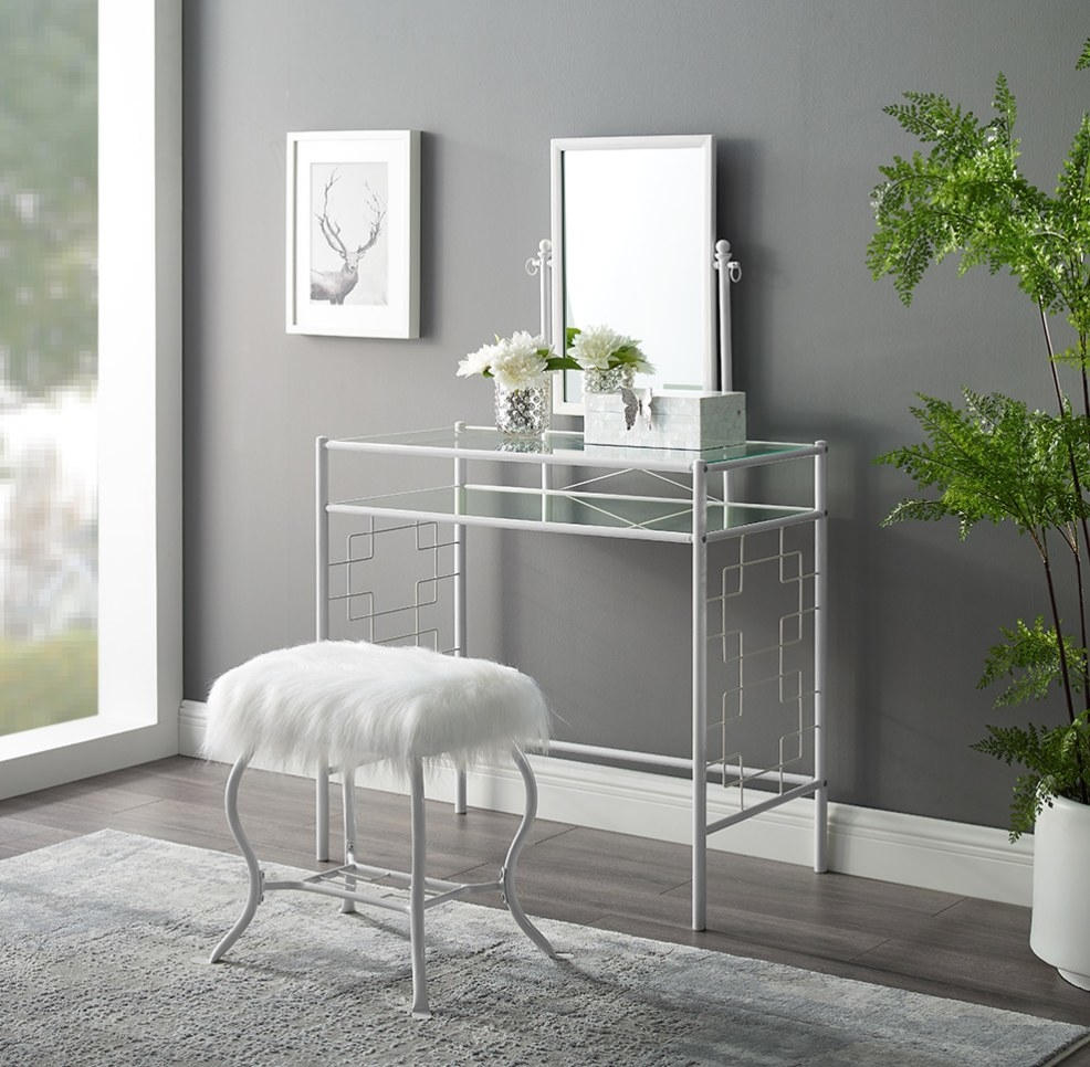 White metal framed vanity with center mirror and glass table top, faux fur white stool
