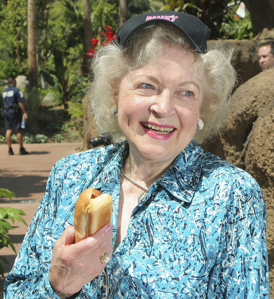 Betty holding another hot dog
