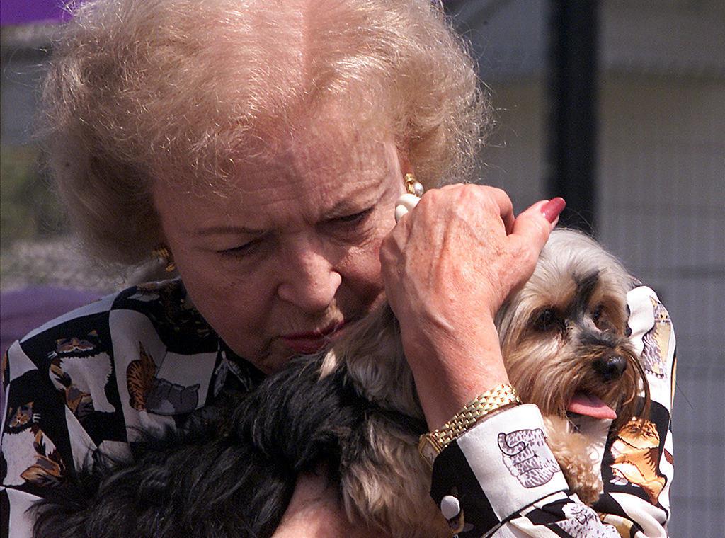 Betty hugging a dog