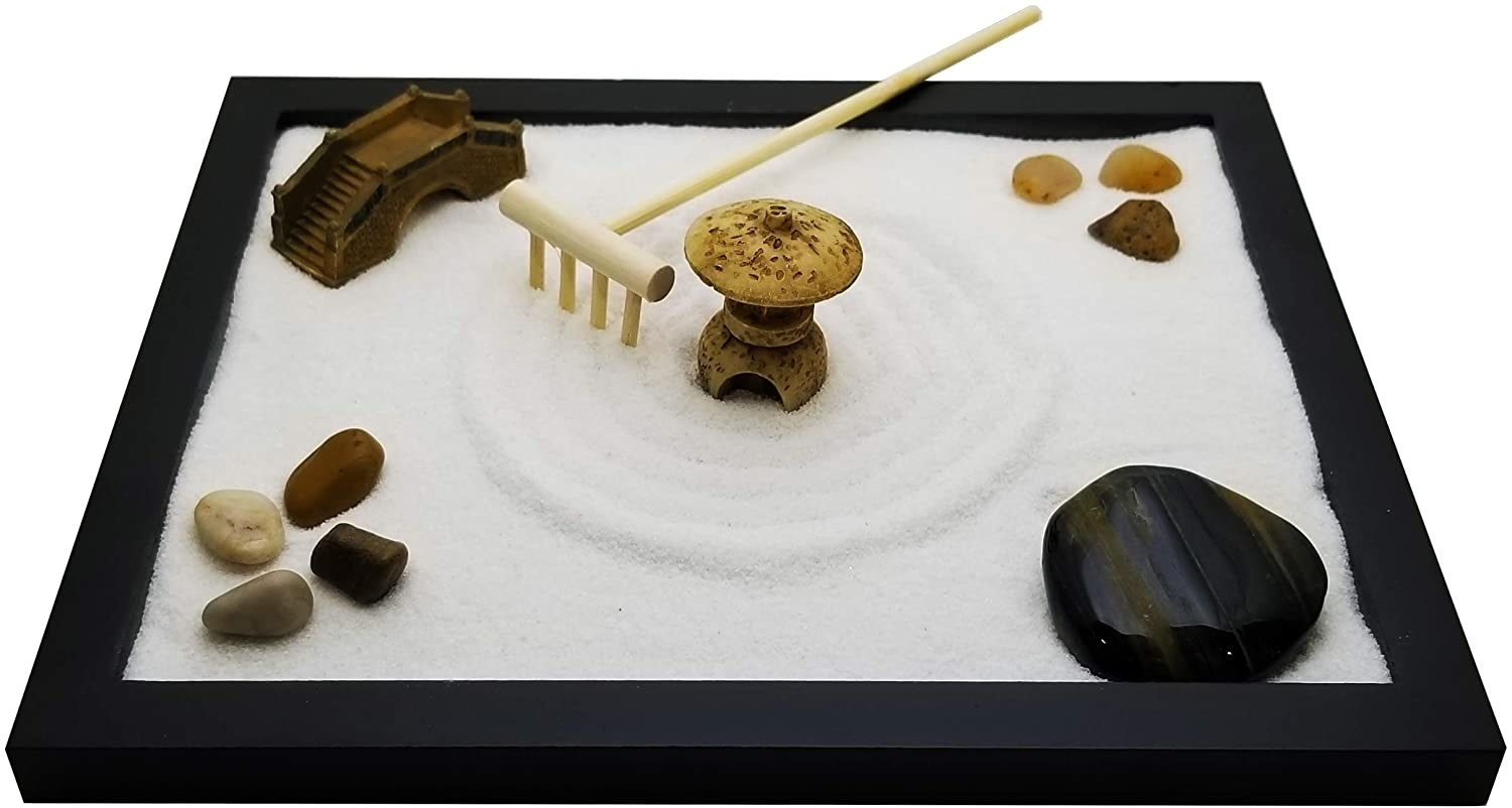 The meditation garden which comes with sand, rocks, figurines, and a rake