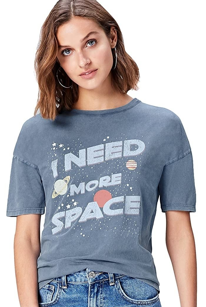 "Model wearing t-shirt with ""I need more space"" graphic"