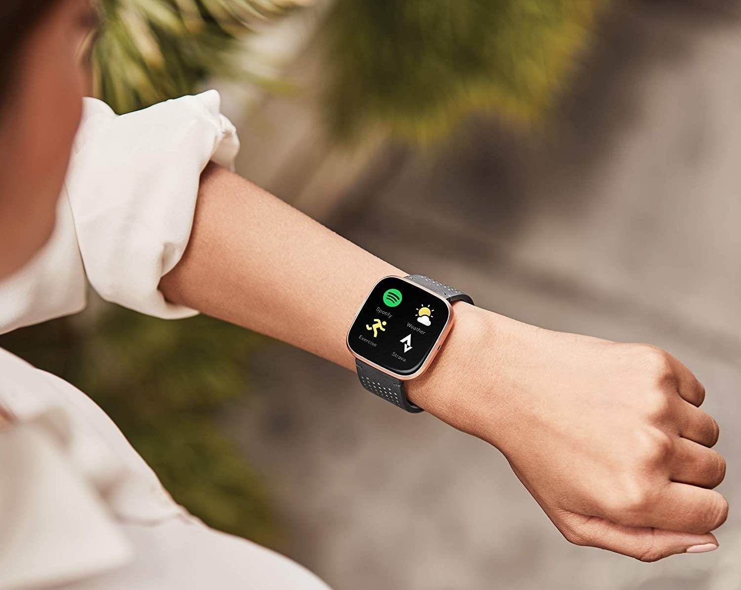 A person wearing a smart watch on their wrist