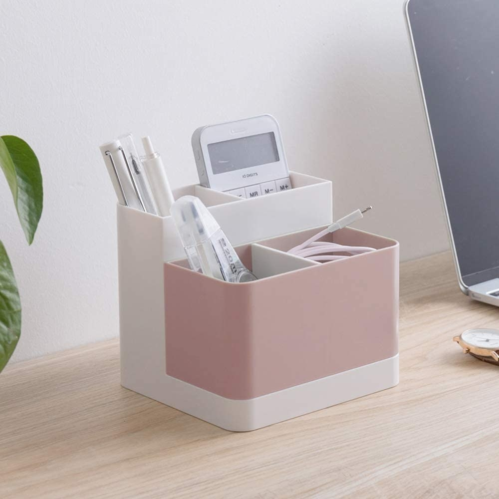 The pink and white organizer which has four compartments