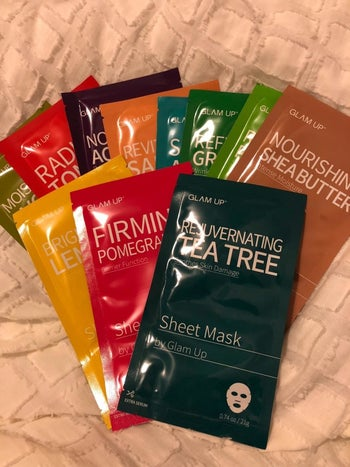 Different-colored Glam Up face masks in a pile