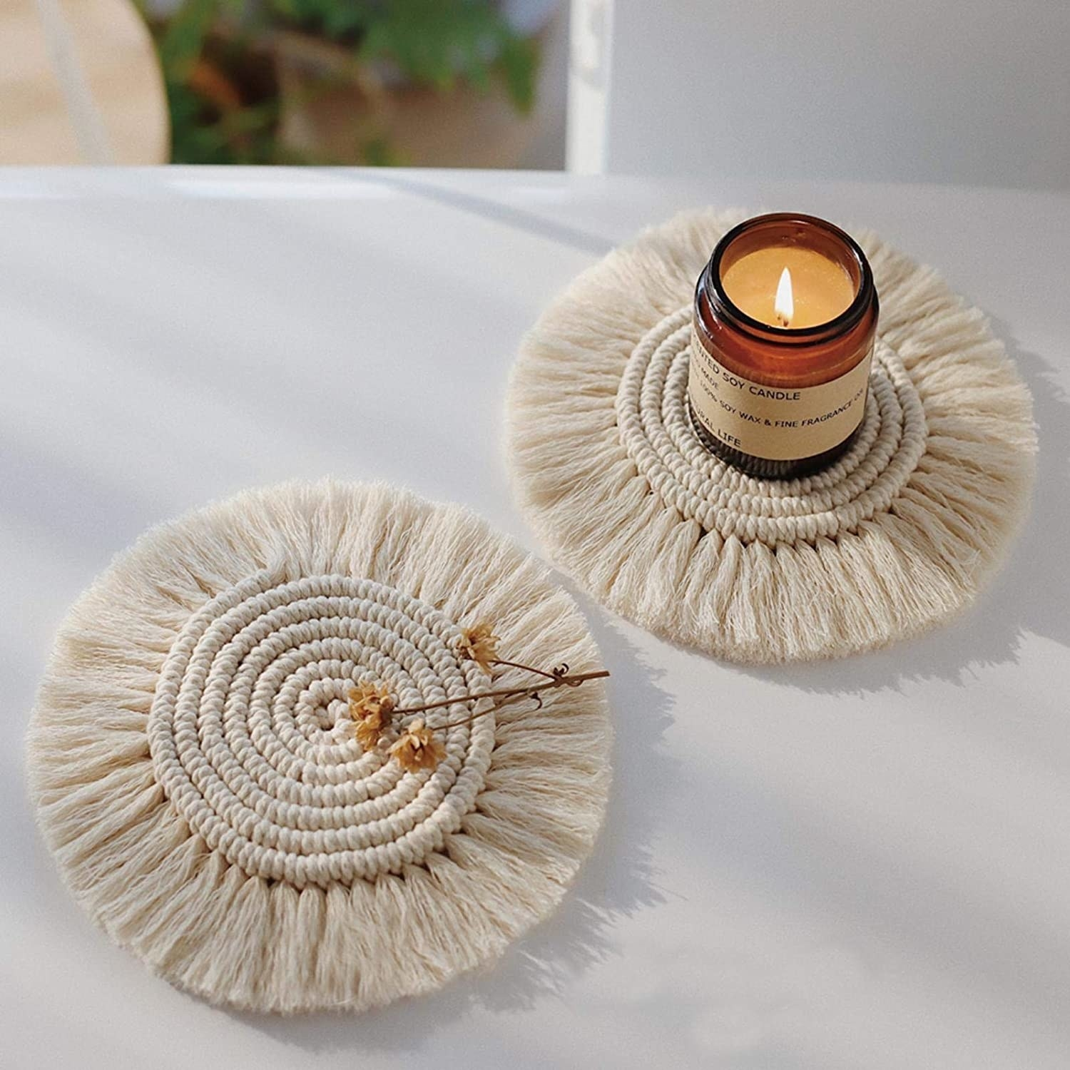Two of the cream macrame coasters