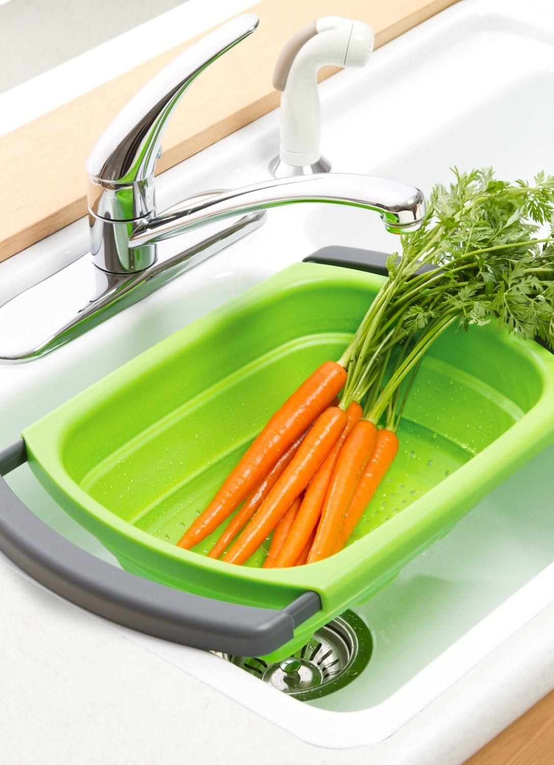 The colander in a sink, with carrots