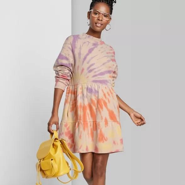 model wears tie dye dress