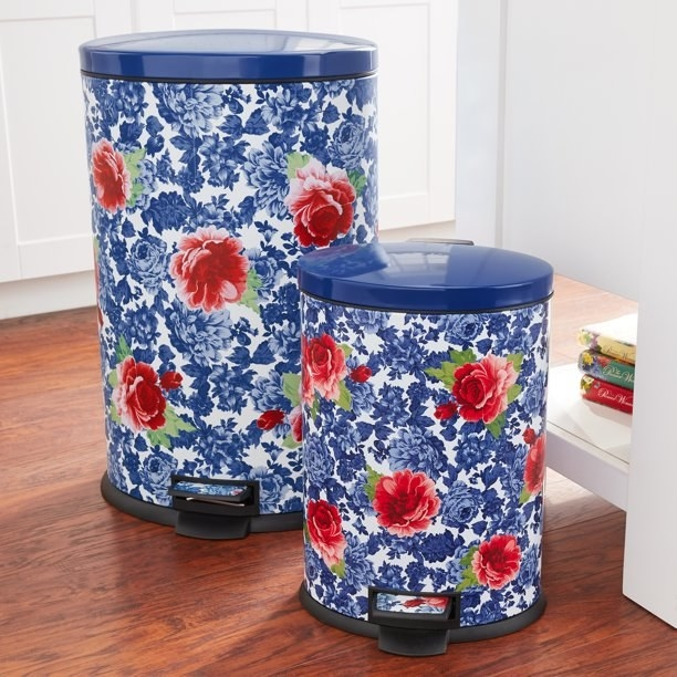 The trash cans, in a blue floral print