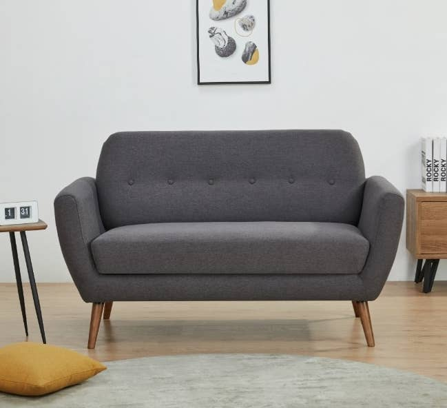 Dark gray love seat with wooden legs