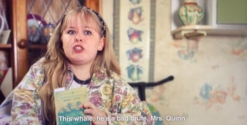 """Clare holds up Moby Dick and says """"This whale, he's a bad brute Mrs Quinn"""""""