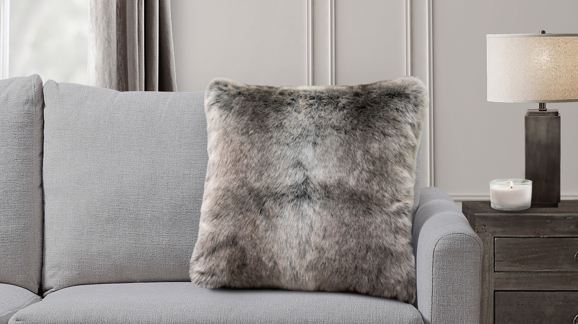 The pillow on a grey couch