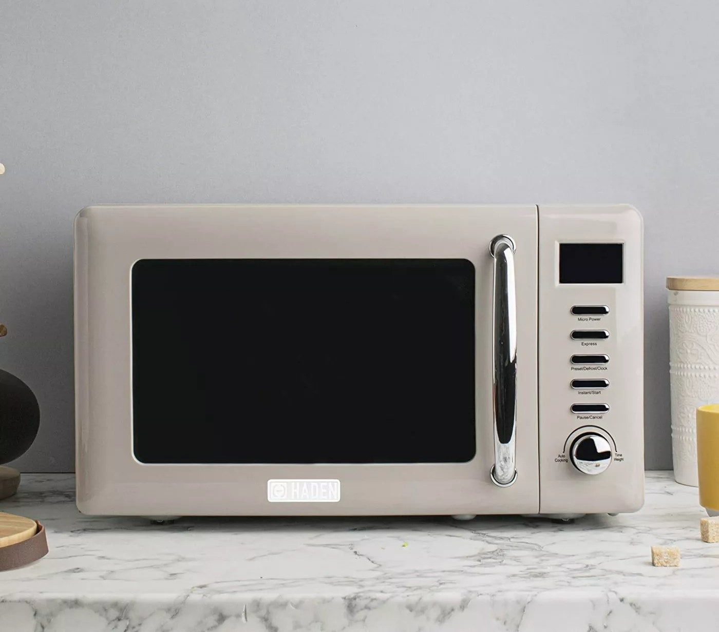 The microwave sitting on a marble countertop