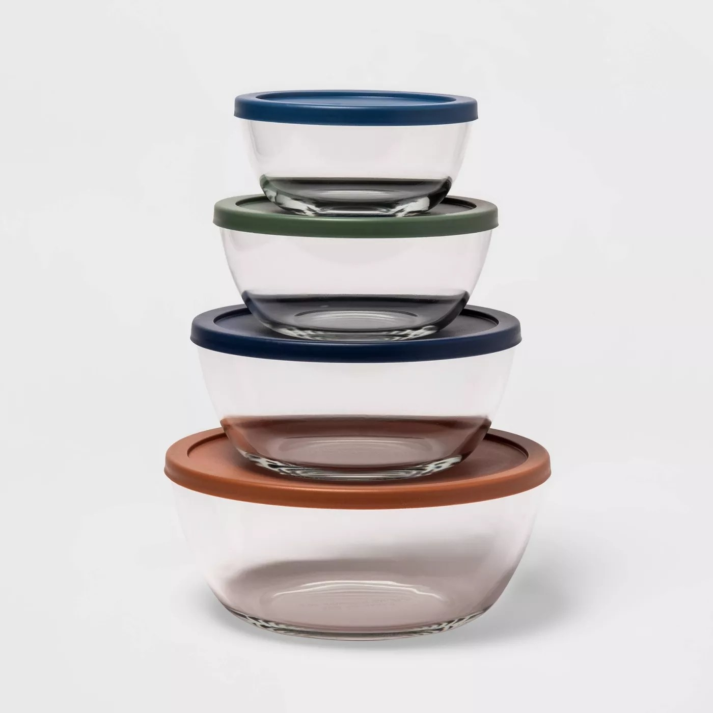 The four containers with lids on, stacked on top of each other