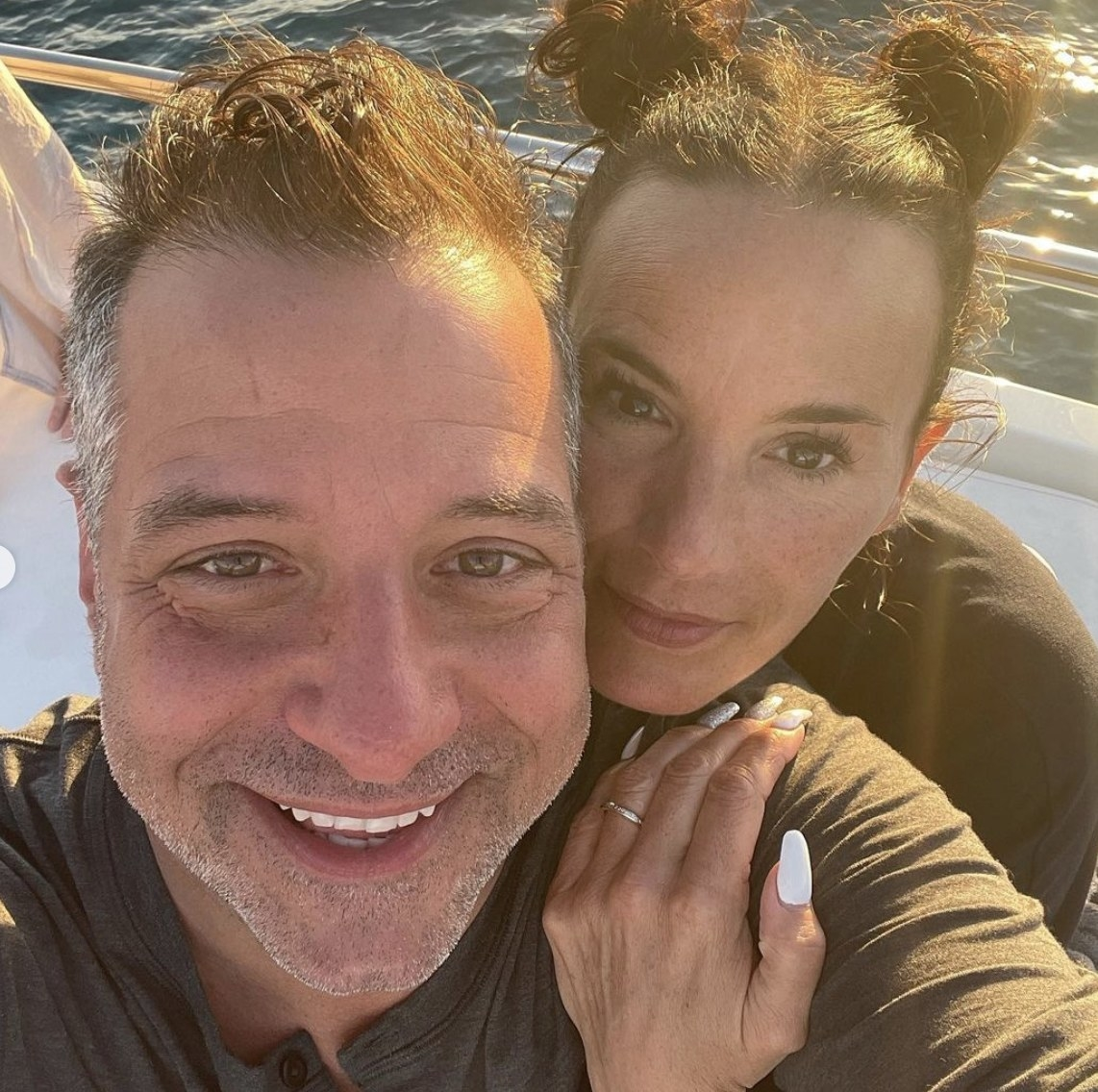 Marc takes a selfie on a boat with Heidi
