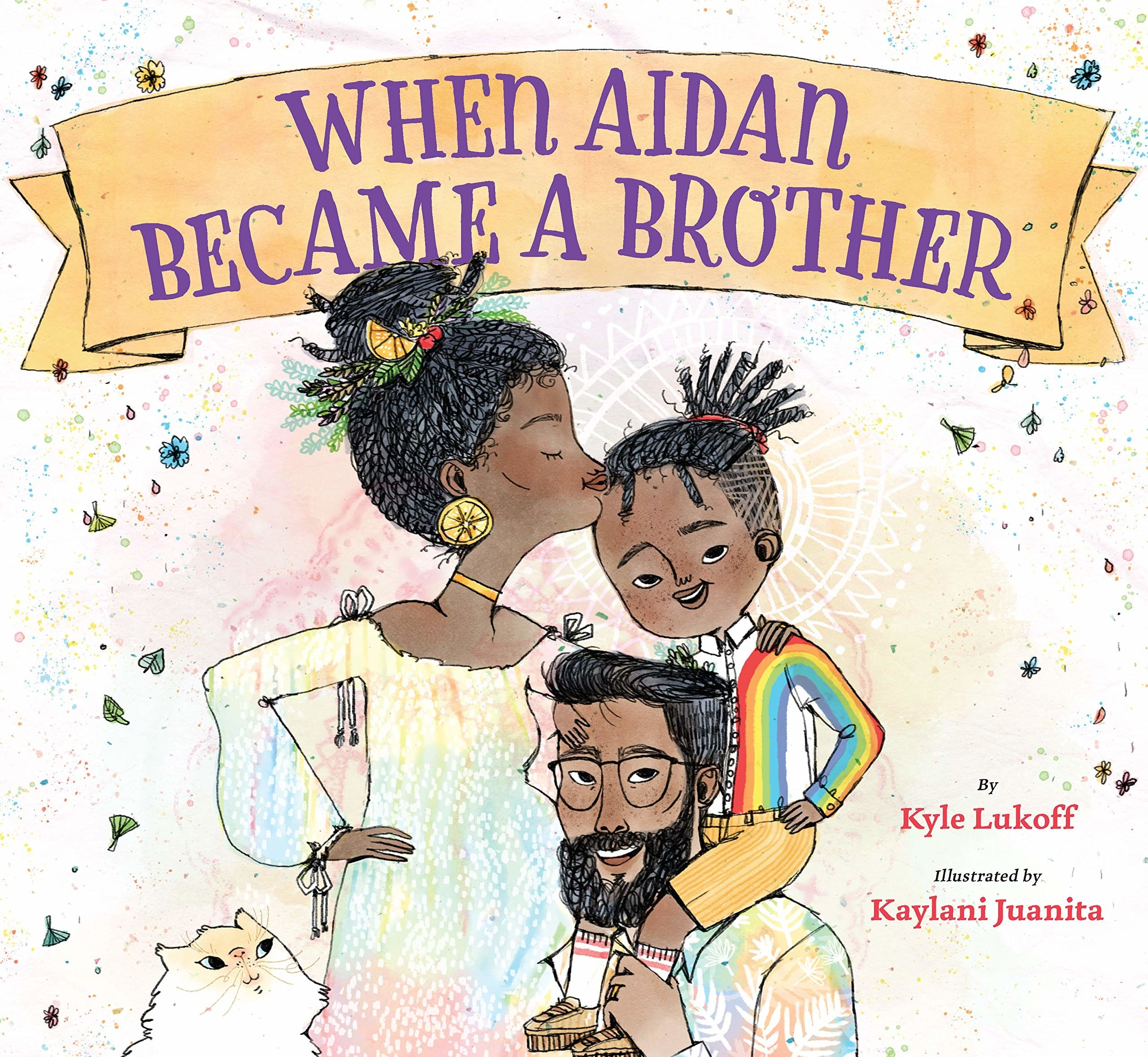 Cover of When Aidan Became A Brother, which shows him wearing a rainbow jacket and sitting on top of his dad's shoulders