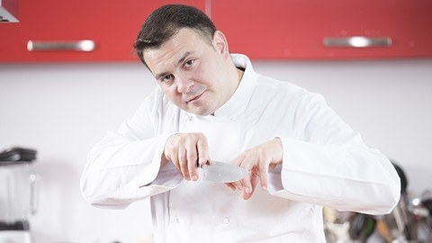 chef posing with a knife