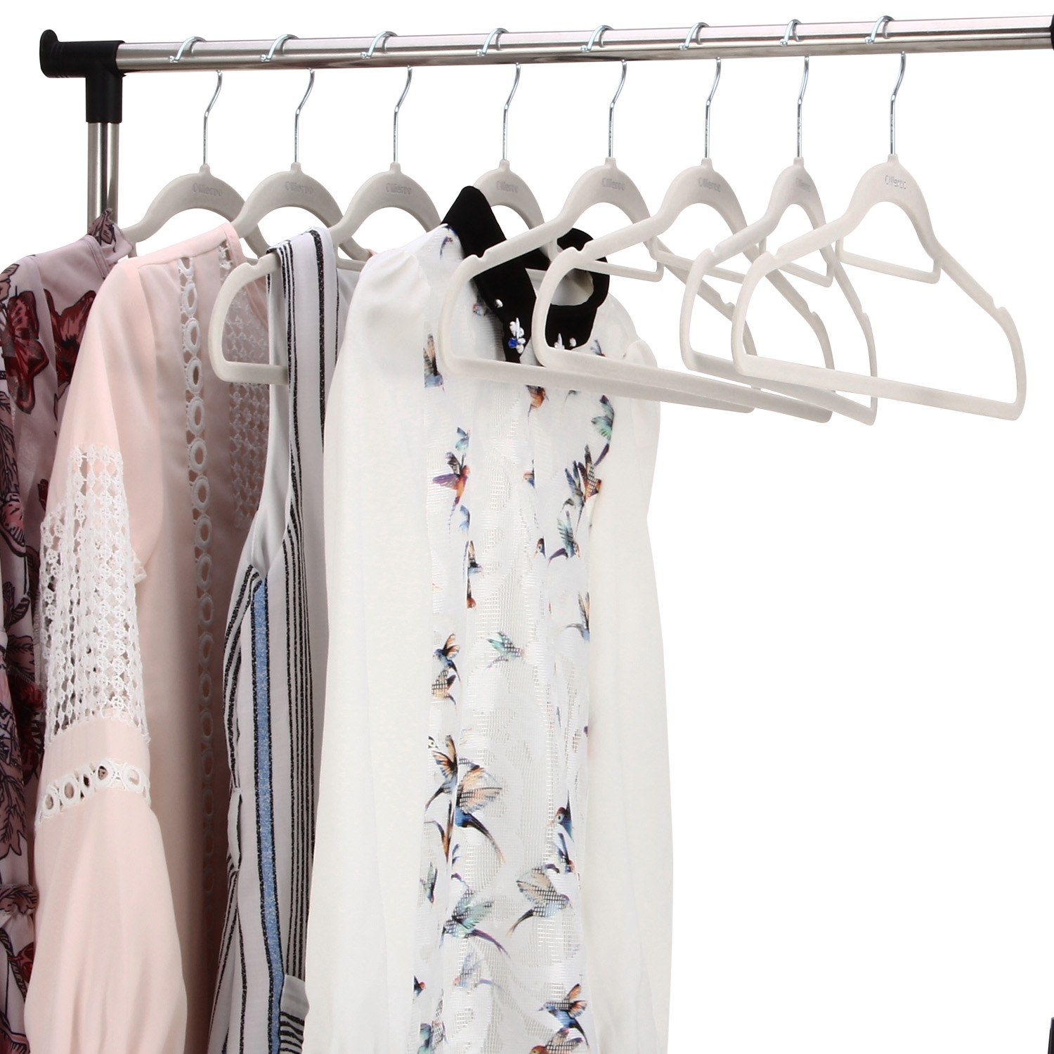 The velvet hangers holding clothes in a closet