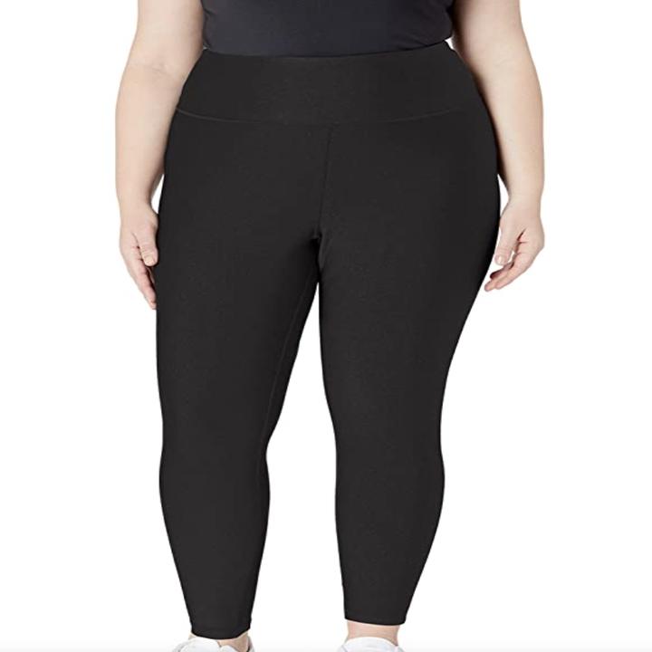 a model in high waisted black leggings