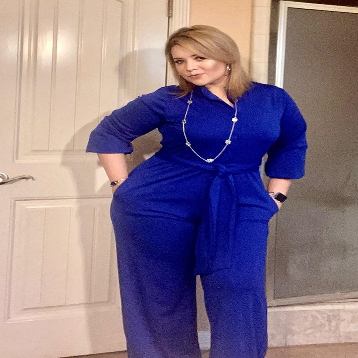 reviewer wearing the 3/4-sleeve jumpsuit in bright blue